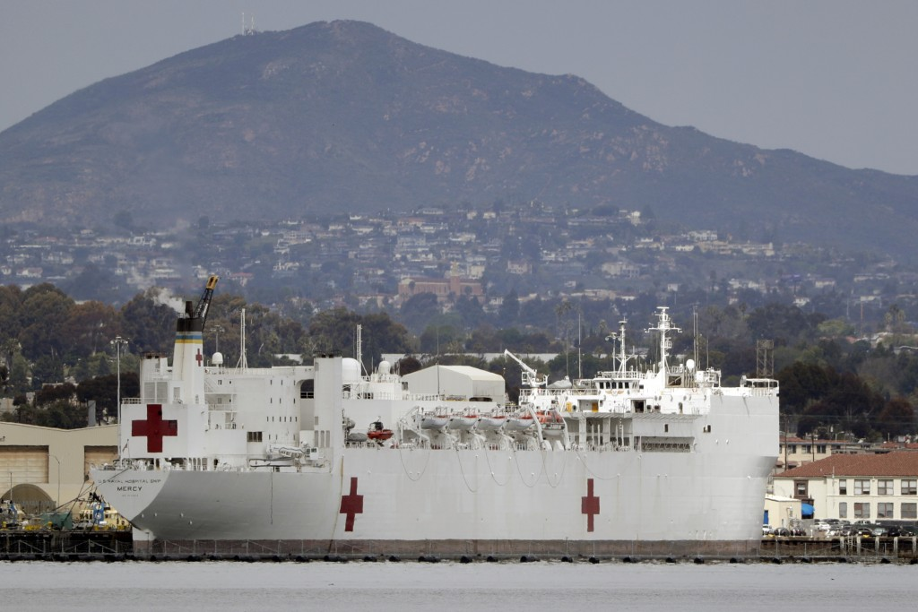 FILE - In this Wednesday, March 18, 2020, file photo, The USNS Mercy, a Navy hospital ship is seen docked at Naval Base San Diego in San Diego, Calif....