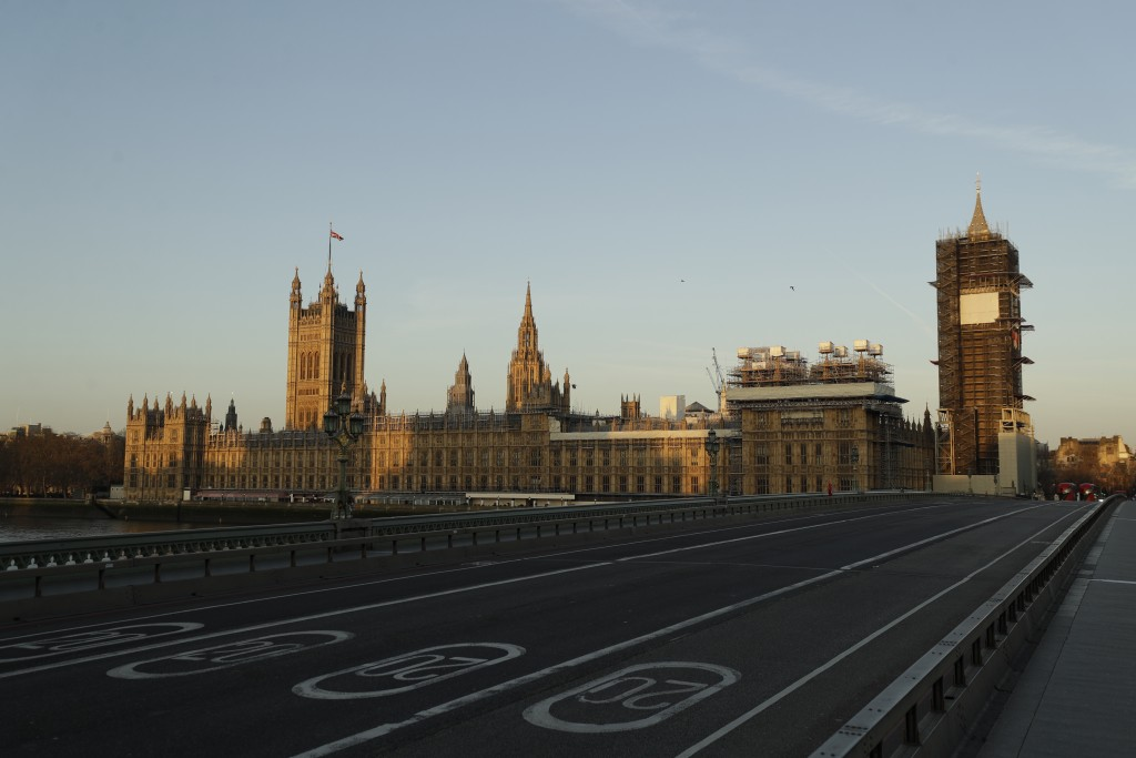 An almost empty Westminster Bridge normally a very busy river crossing as the sun rises in London, Tuesday, March 24, 2020. Britain's Prime Minister B...