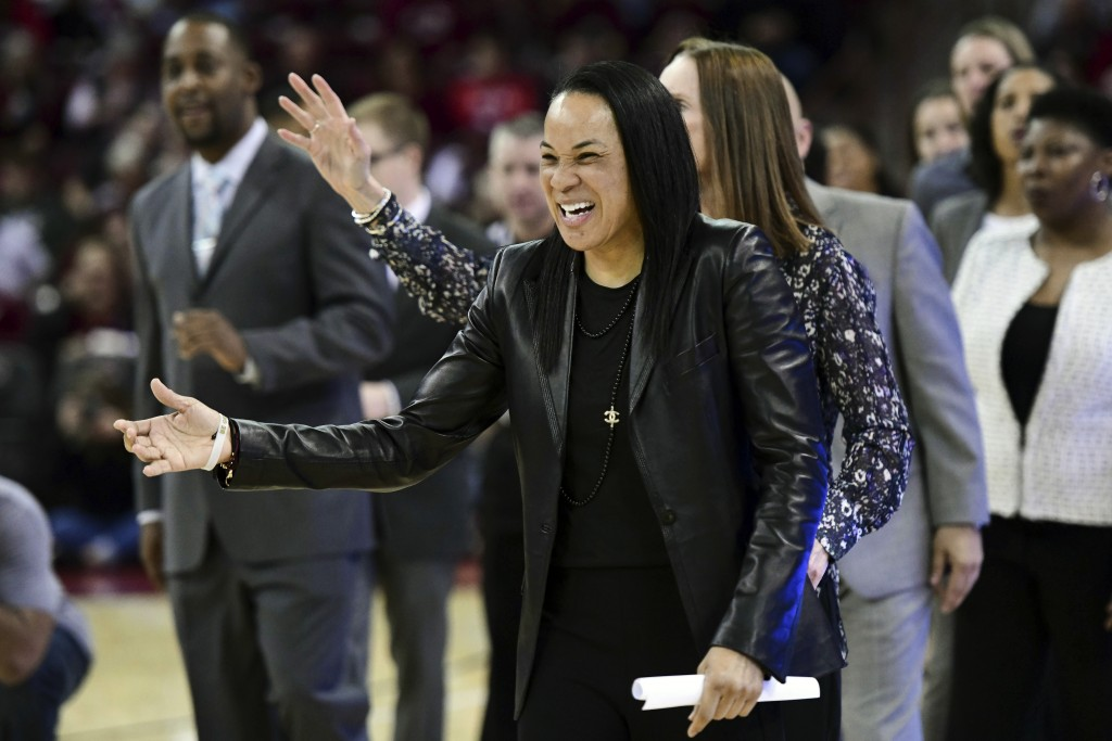 FILE - In this Feb. 17, 2020, file photo, South Carolina coach Dawn Staley laughs before an NCAA college basketball game against Vanderbilt in Columbi...