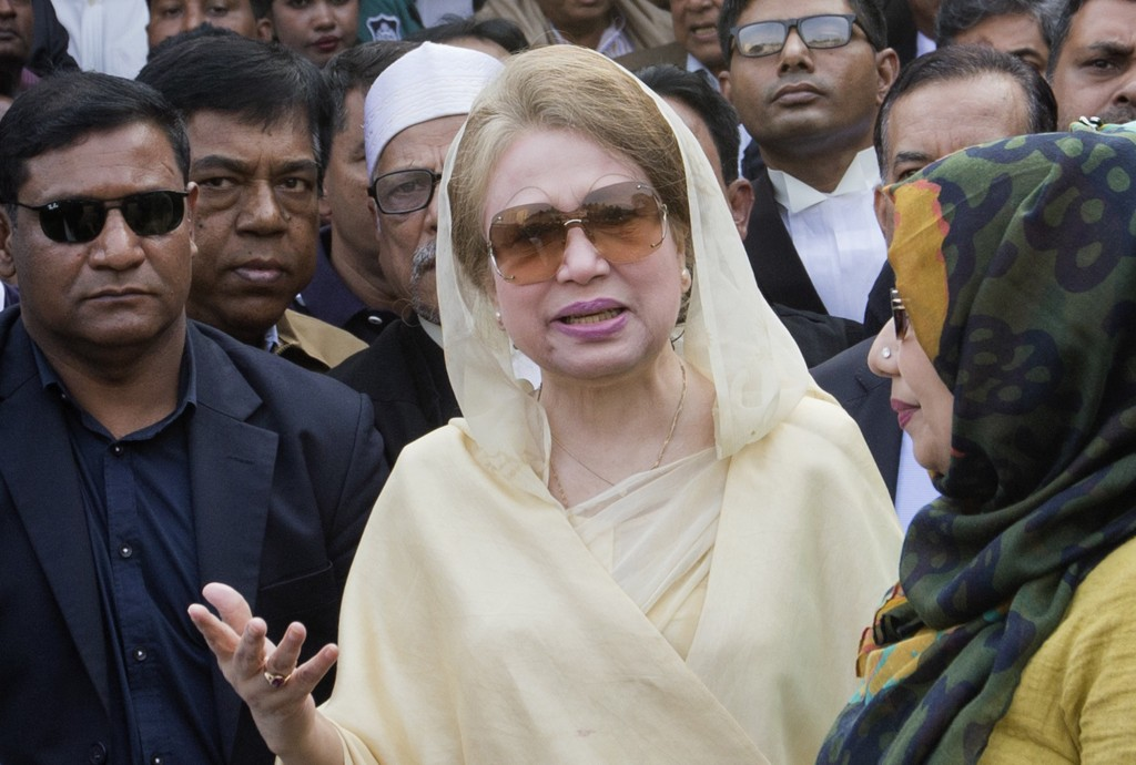 FILE- In this Dec. 28, 2017, file photo, Bangladesh's former prime minister and Bangladesh Nationalist Party (BNP) chairperson Khaleda Zia, center, le...