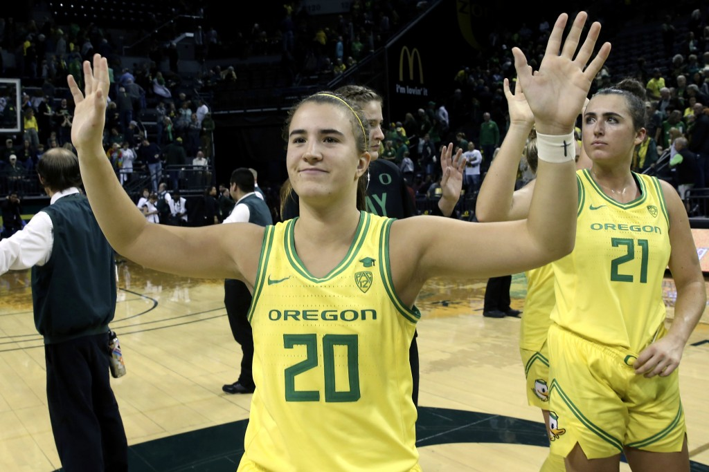 FILE - In this Nov. 16, 2019, file photo, Oregon's Sabrina Ionescu acknowledges the crowd with teammates after an NCAA college basketball game against...
