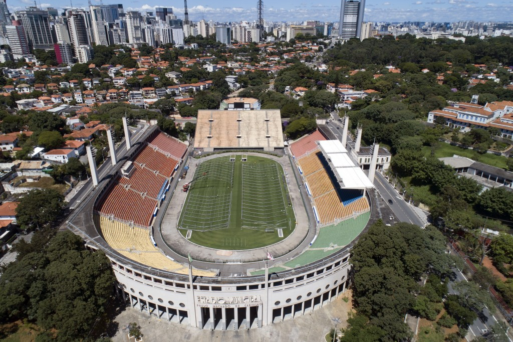 The field of the Pacaembu stadium is lined with metal frames as workers erect an open-air hospital to treat patients who have COVID-19 in Sao Paulo, B...