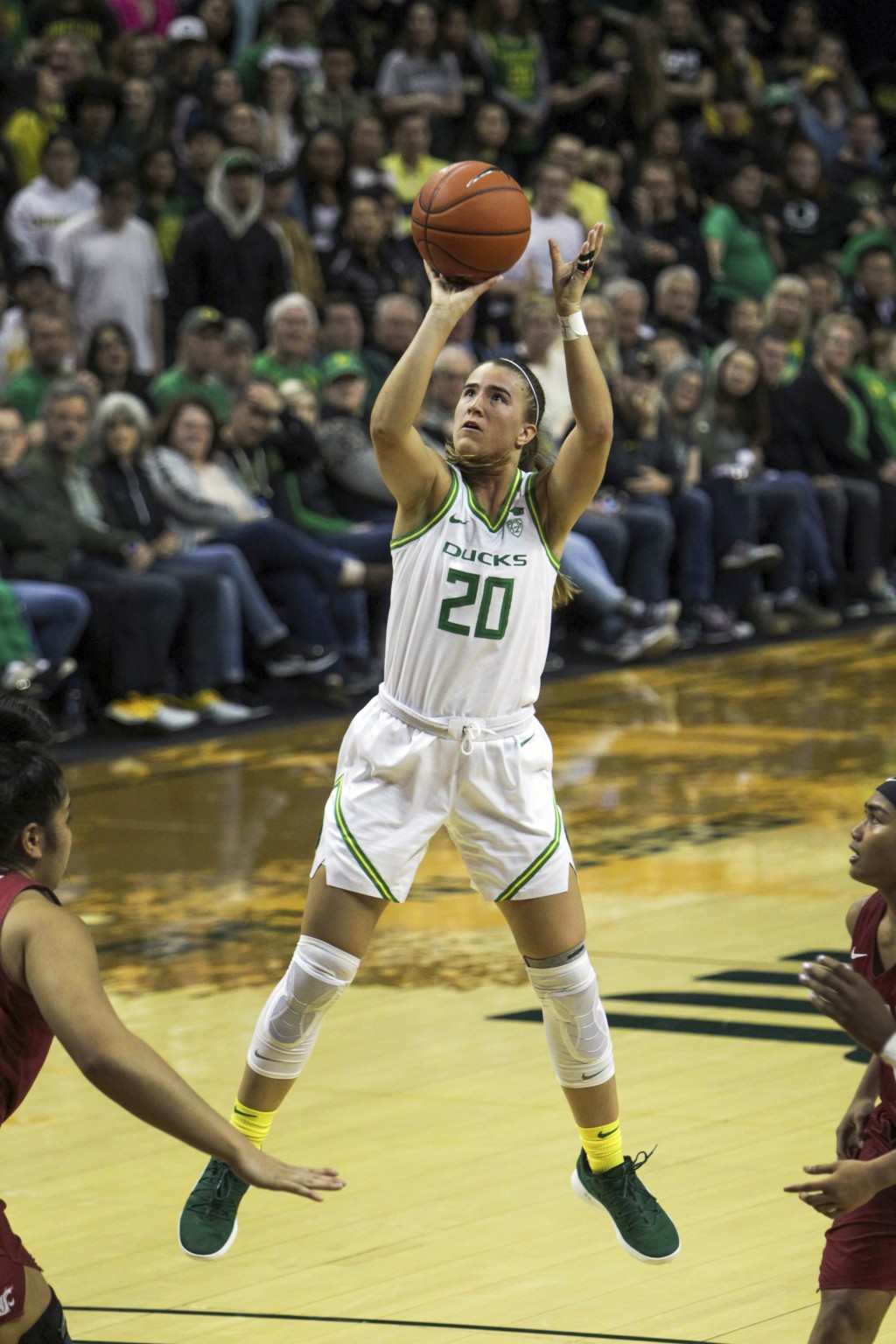 FILE - In this Friday, Feb. 28, 2020, file photo, Oregon's Sabrina Ionescu shoots against Washington State in an NCAA college basketball game in Eugen...