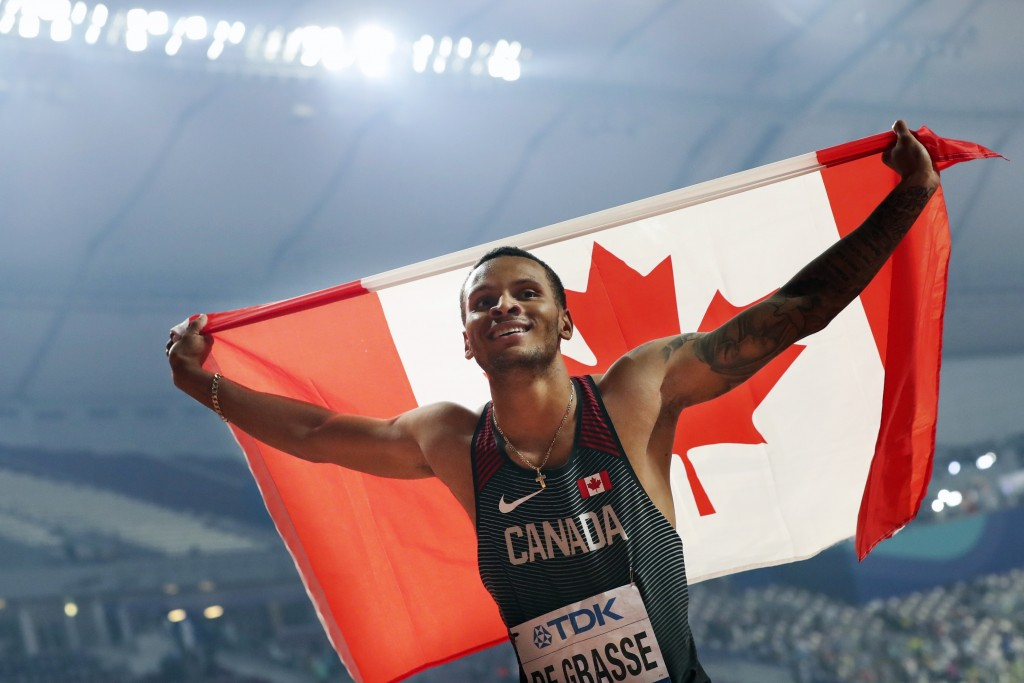 FILE - In this Tuesday, Oct. 1, 2019, file photo, Canada's Andre De Grasse celebrates after winning the silver medal in the men's 200-meters at the Wo...