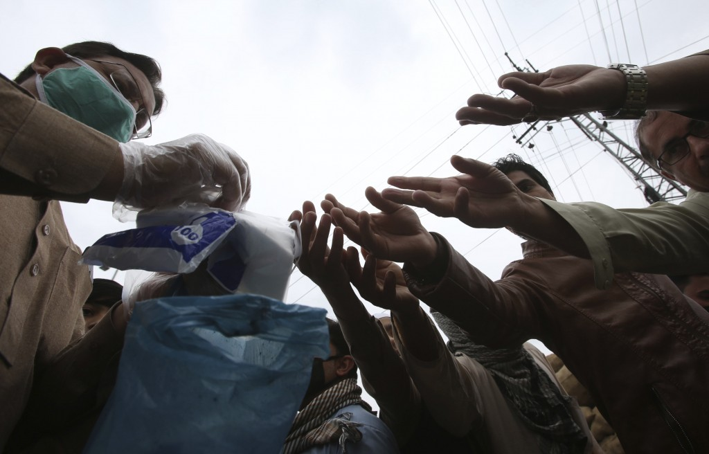 People buy gloves to avoid the spread of coronavirus outbreak in Peshawar, Pakistan, Tuesday, March 24, 2020. Pakistani authorities said they'd shut d...