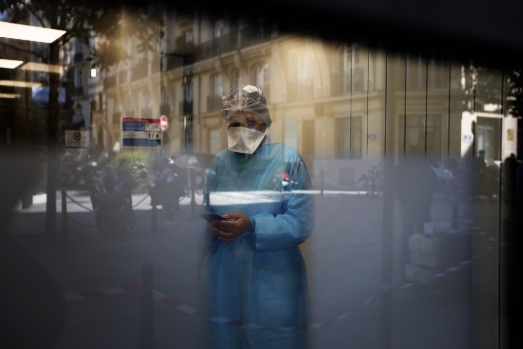 Biologist doctor Caroline Gutsmuth gives a phone call in medical biology laboratory who opened a coronavirus drive-thru testing site, in Neuilly-sur-S...