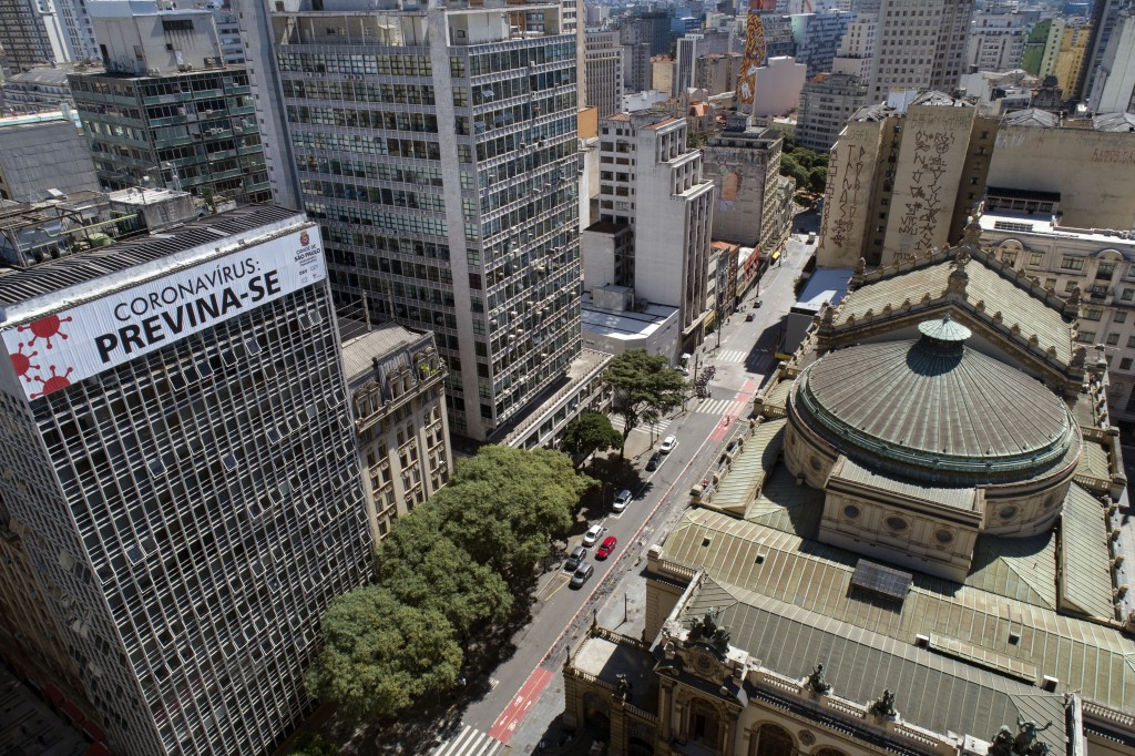 """A building is covered by the Portuguese message: """"Coronavirus: take precaution"""" over empty streets in downtown Sao Paulo, Brazil, Monday, March 23, 20..."""