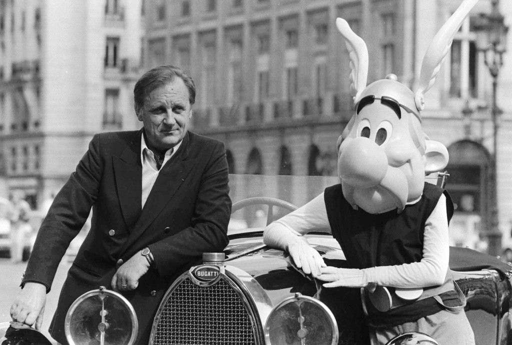 FILE - In this Sept. 1985 file photo, French author and illustrator Albert Uderzo poses with character Asterix in Paris. Albert Underzo, one of the tw...