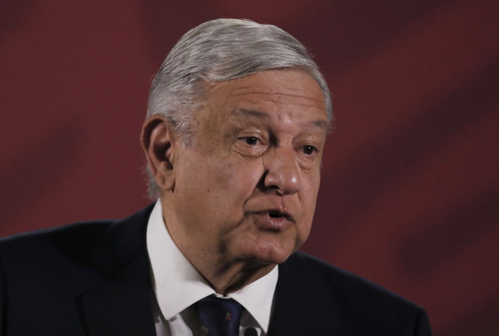 Mexico's President Andres Manuel Lopez Obrador arrives for his daily news conference, with health officials, at the presidential palace in Mexico City...