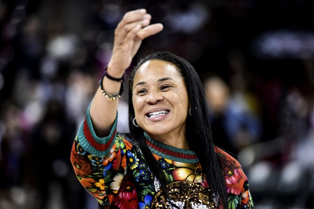 FILE- In this Dec. 15, 2019, file photo, South Carolina head coach Dawn Staley participates in the school anthem after an NCAA college basketball game...