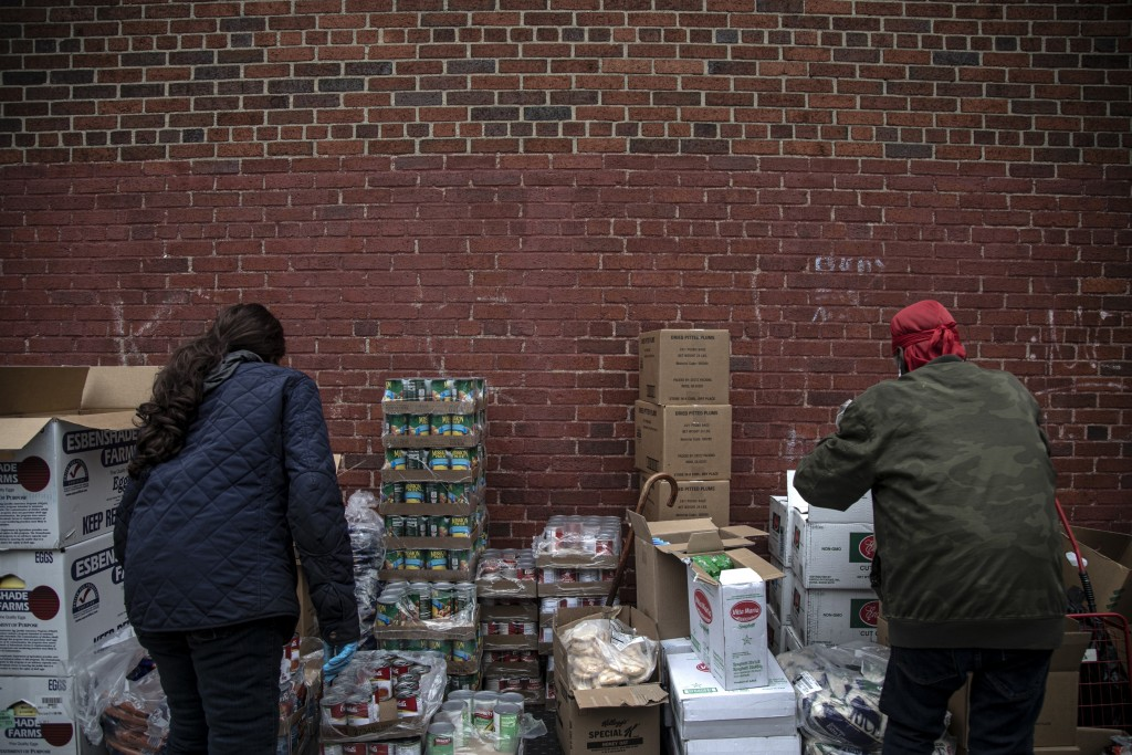 Volunteers prepare donations at St. Stephen Outreach in the Brooklyn borough of New York, on Friday, March 20, 2020. One out of four Americans volunte...