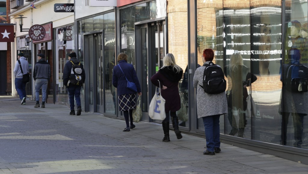 People use social distancing as they queue to enter a supermarket in Windsor, England Tuesday, March 24, 2020. Britain's Prime Minister Boris Johnson ...