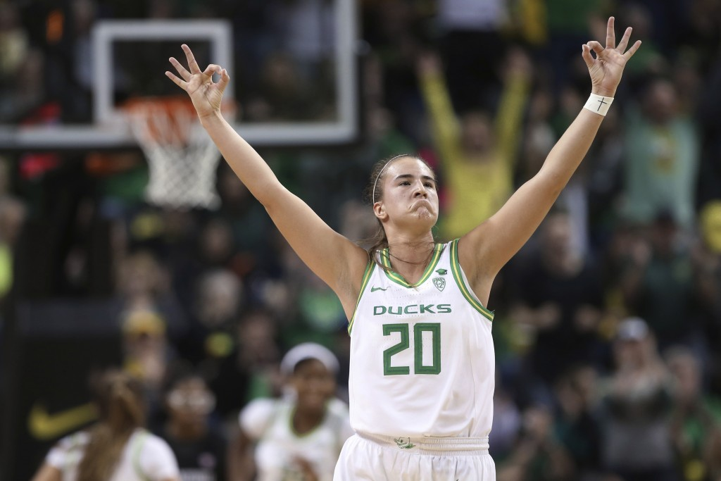 FILE - In this Thursday, Jan. 16, 2020, file photo, Oregon's Sabrina Ionescu celebrates a 3-point shot against Stanford during the third quarter of an...