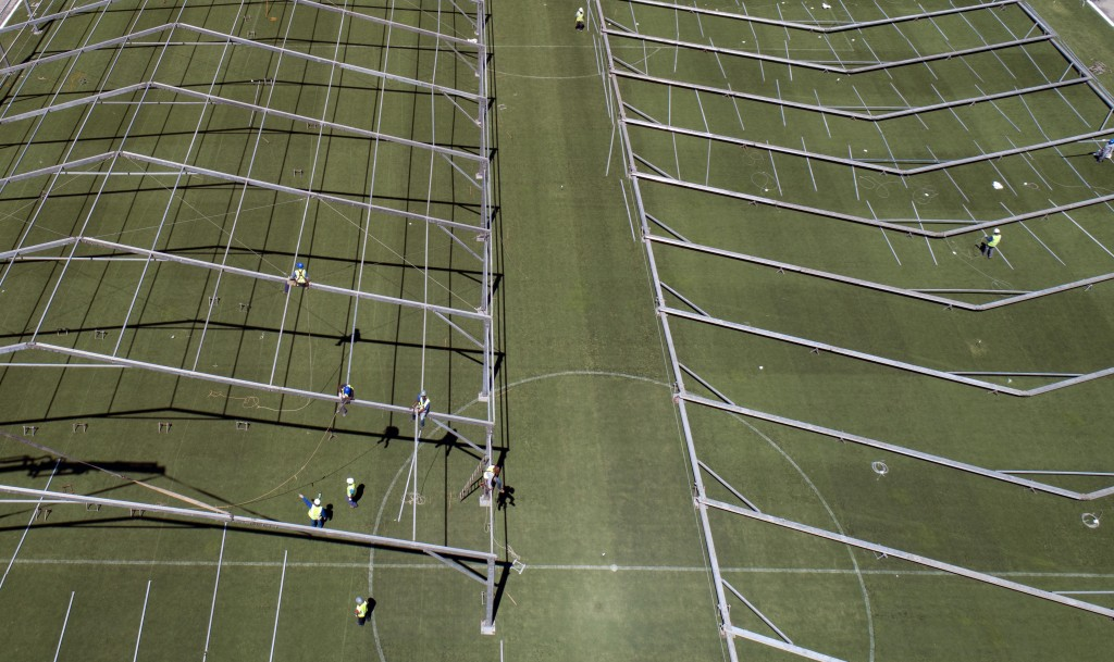 The field of Pacaembu stadium is lined with metal frames as workers erect an open-air hospital to treat patients who have COVID-19 in Sao Paulo, Brazi...