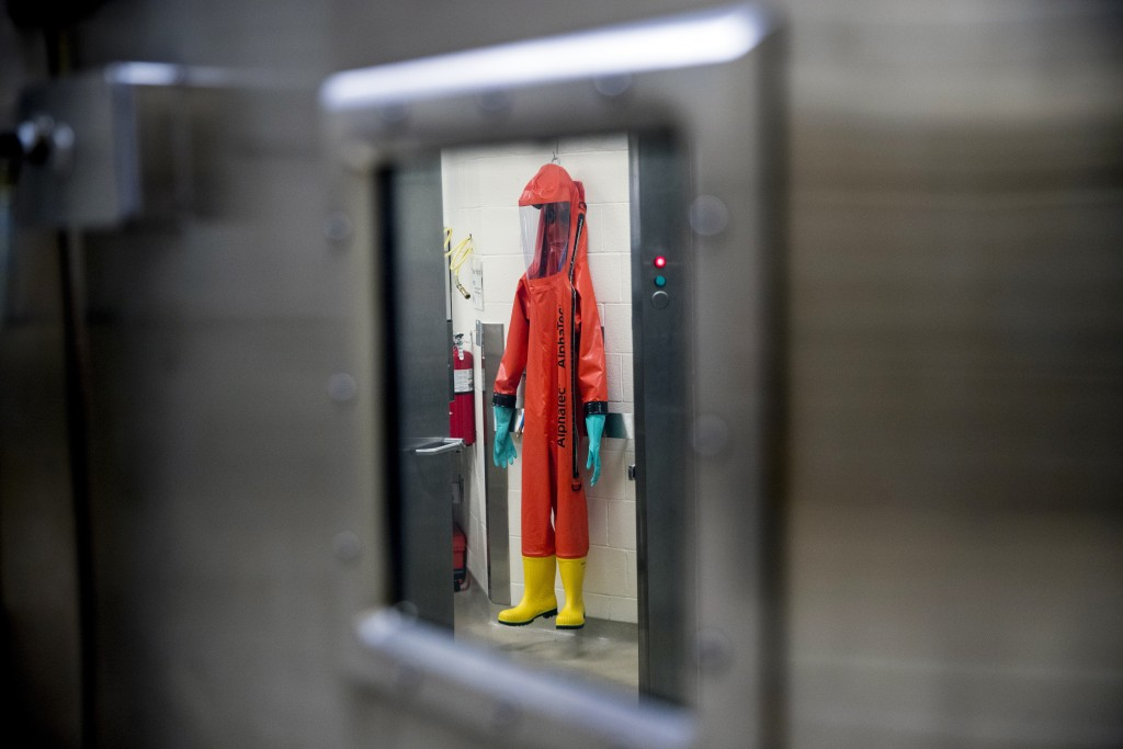 A biosafety protective suit for handling viral diseases are hung up in a biosafety level 4 training facility at U.S. Army Medical Research and Develop...