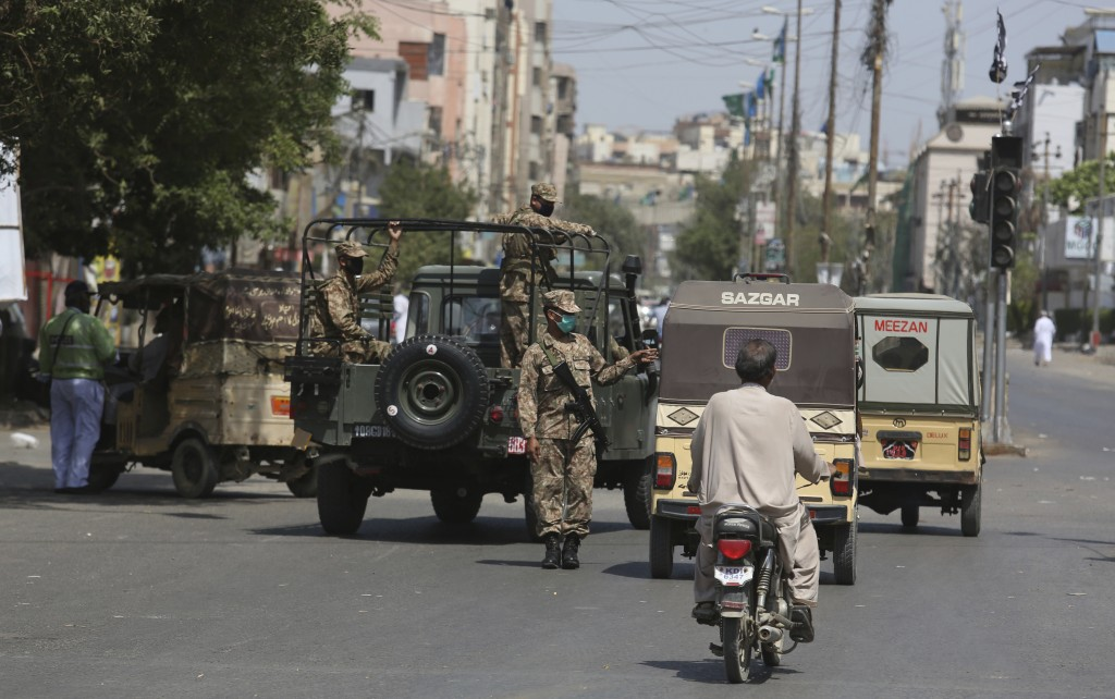 Pakistani troops stop vehicles to implement a lockdown in an effort to contain the outbreak of the coronavirus in Karachi, Pakistan, Tuesday, March 24...