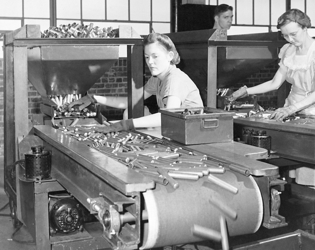 FILE - In this June 26, 1942, file photo, women workers at the St. Louis Ordnance plant inspect 50 calibre shell casings. This is the first inspection...