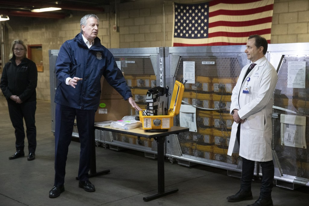 New York City Mayor Bill de Blasio, left, discusses the arrival of a shipment of 400 ventilators with Dr. Steven Pulitzer, the Chief Medical Officer o...
