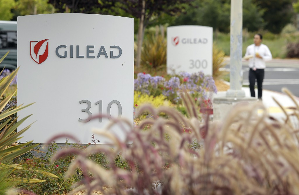FILE - In this July 9, 2015, file photo, a man walks outside the headquarters of Gilead Sciences in Foster City, Calif. Gilead Sciences said Wednesday...