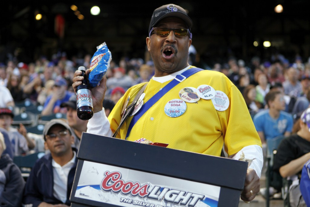 FILE - In this May 9, 2011, file photo, a vendor sells beer and peanuts at a Colorado Rockies baseball game at Coors Field in Denver. There will be em...