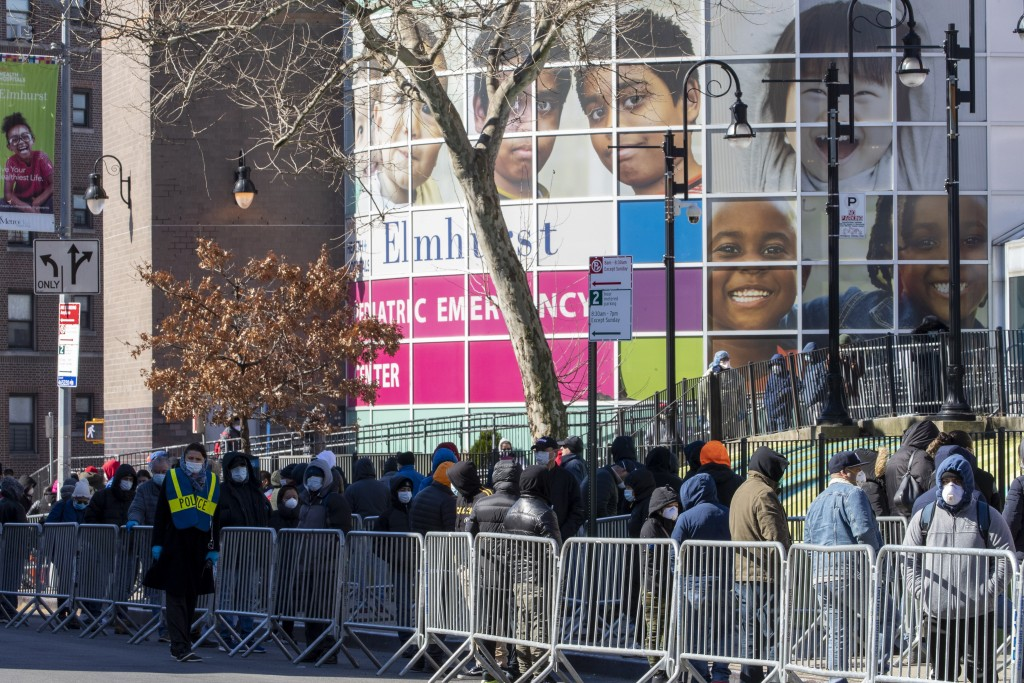 People line up outside Elmhurst Hospital Center to be tested for the coronavirus, Tuesday, March 24, 2020, in the Queens borough of New York. New York...