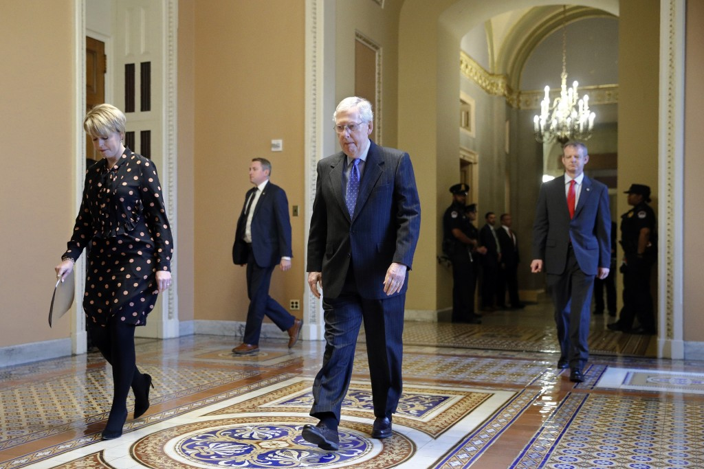 Senate Majority Leader Mitch McConnell of Ky. walks to the Senate chamber on Capitol Hill in Washington, Tuesday, March 24, 2020. (AP Photo/Patrick Se...