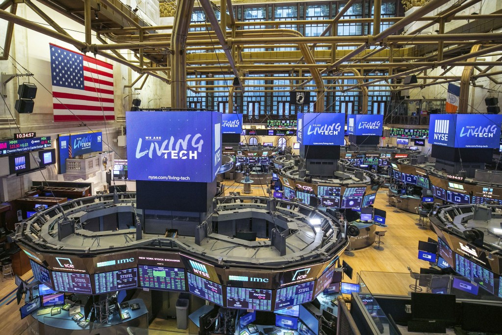 This photo provided by the New York Stock Exchange shows the unoccupied NYSE trading floor, closed temporarily for the first time in 228 years as a re...