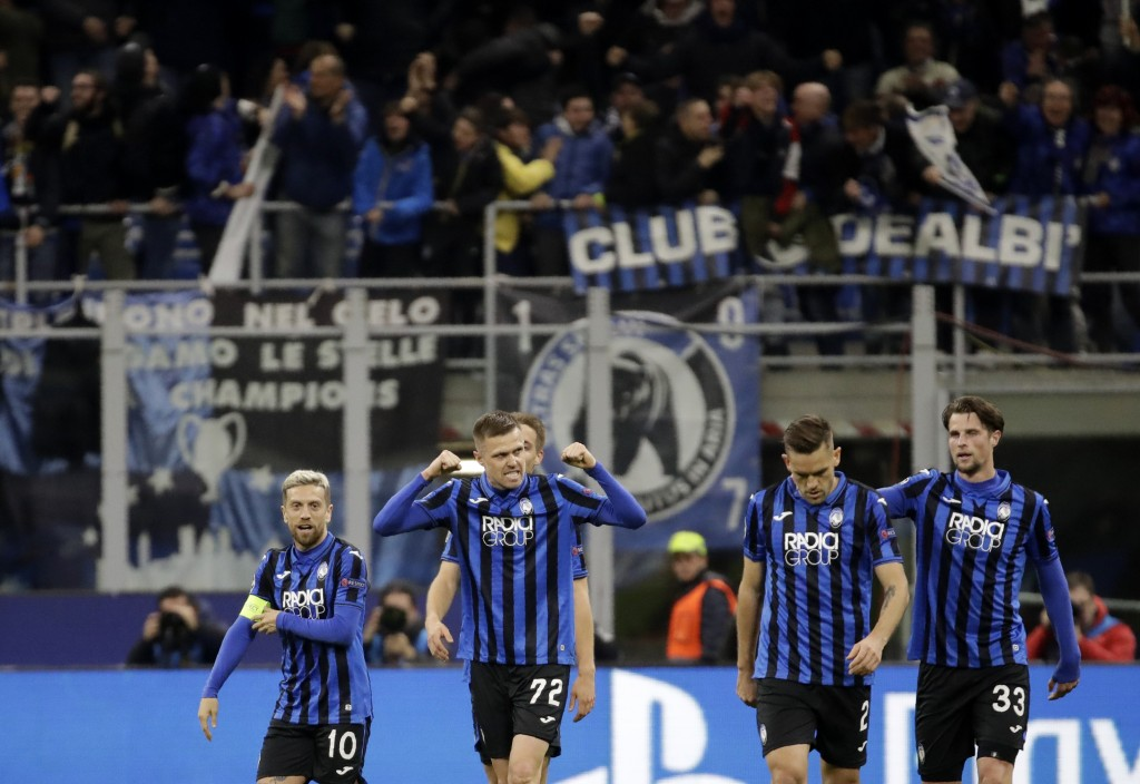 FILE - In this Wednesday, Feb. 19, 2020 file photo, Atalanta's Josip Ilicic, second left, celebrates with teammates after scoring his side's second go...