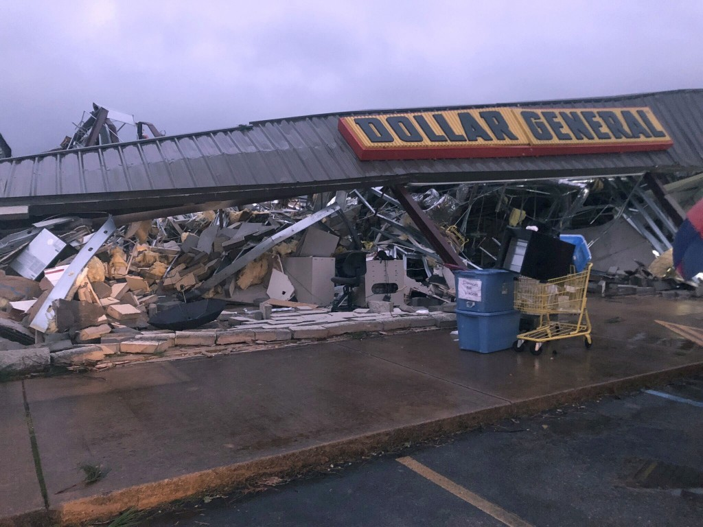 In this Tuesday, March 24, 2020 photo, a Dollar General store in Tishomingo, Miss., is completely destroyed after a suspected tornado swept through th...