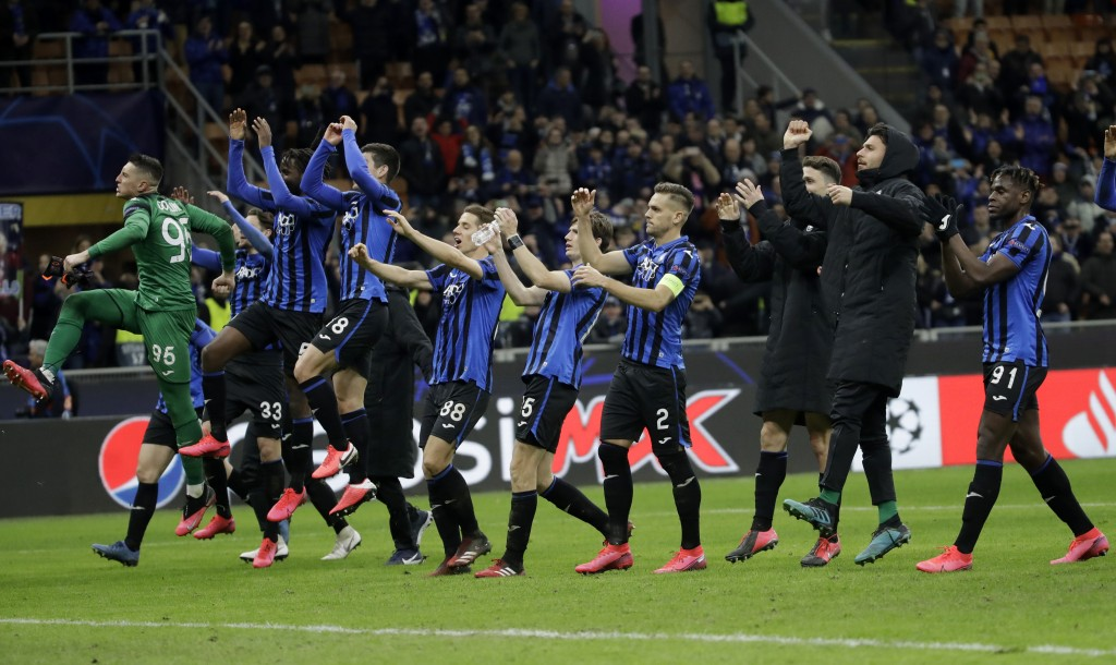 FILE - In this Wednesday, Feb. 19, 2020 file photo, Atalanta players celebrate at the end of the Champions League round of 16, first leg, soccer match...