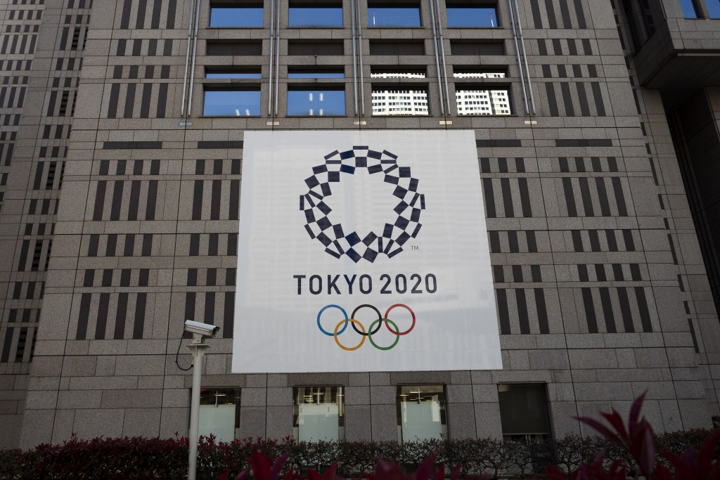 A banner promoting the Tokyo 2020 Olympics hands on the facade of the Tokyo Metropolitan Government building Wednesday, March 25, 2020, in Tokyo. Not ...