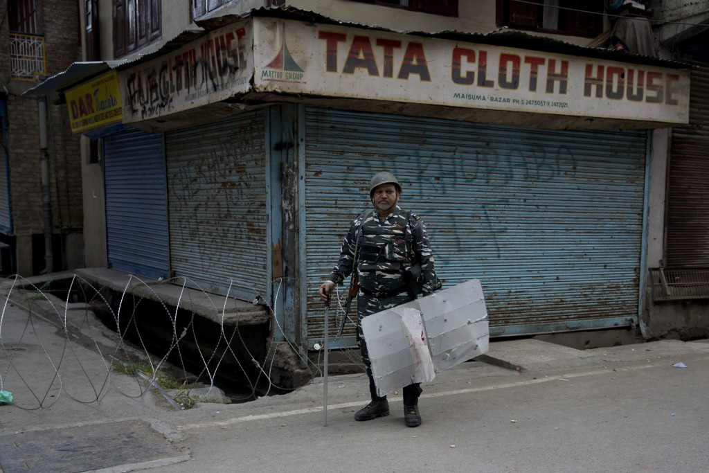 FILE - In this Aug. 9, 2019 file photo, an Indian Paramilitary soldier stands guard during curfew in Srinagar, Indian controlled Kashmir. Western coun...
