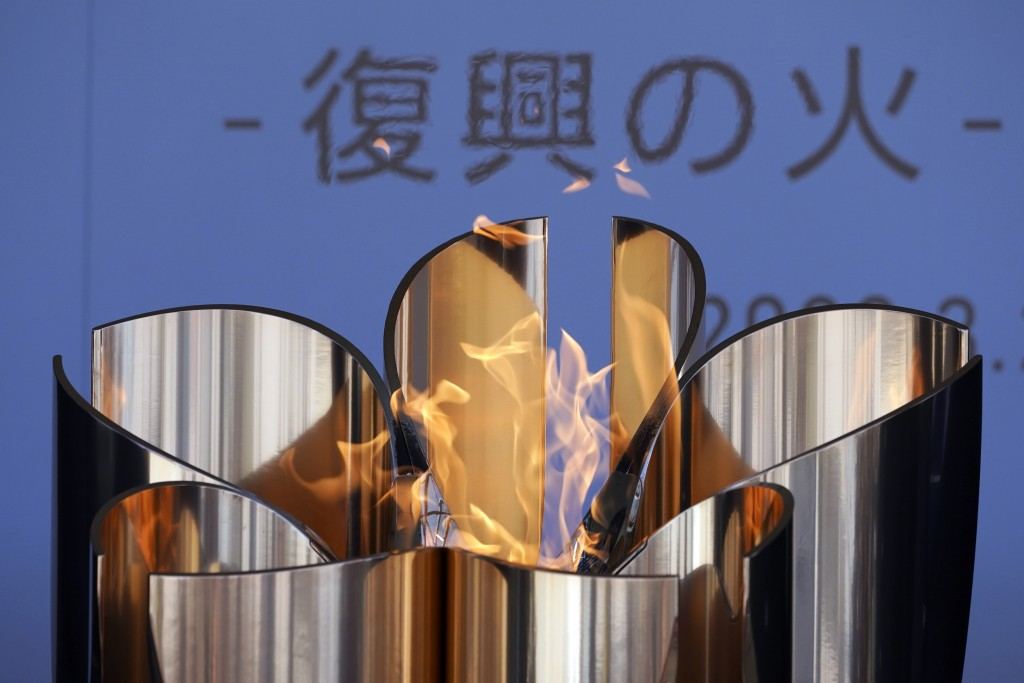 """The Olympic Flame burns during the Olympic """"Flame of Recovery"""" display ceremony in Iwaki, northern Japan Wednesday, March 25, 2020. IOC President Thom..."""
