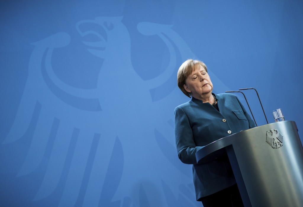 FILE - In this Sunday, March 22, 2020, file photo, German Chancellor Angela Merkel speaks at a news conference about the new coronavirus, in Berlin. W...