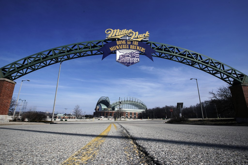 FILE - In this March 24, 2020, file photo, Miller Park is seen in Milwaukee. The Brewers were supposed to host Opening Day on Thursday, March 26, 2020...