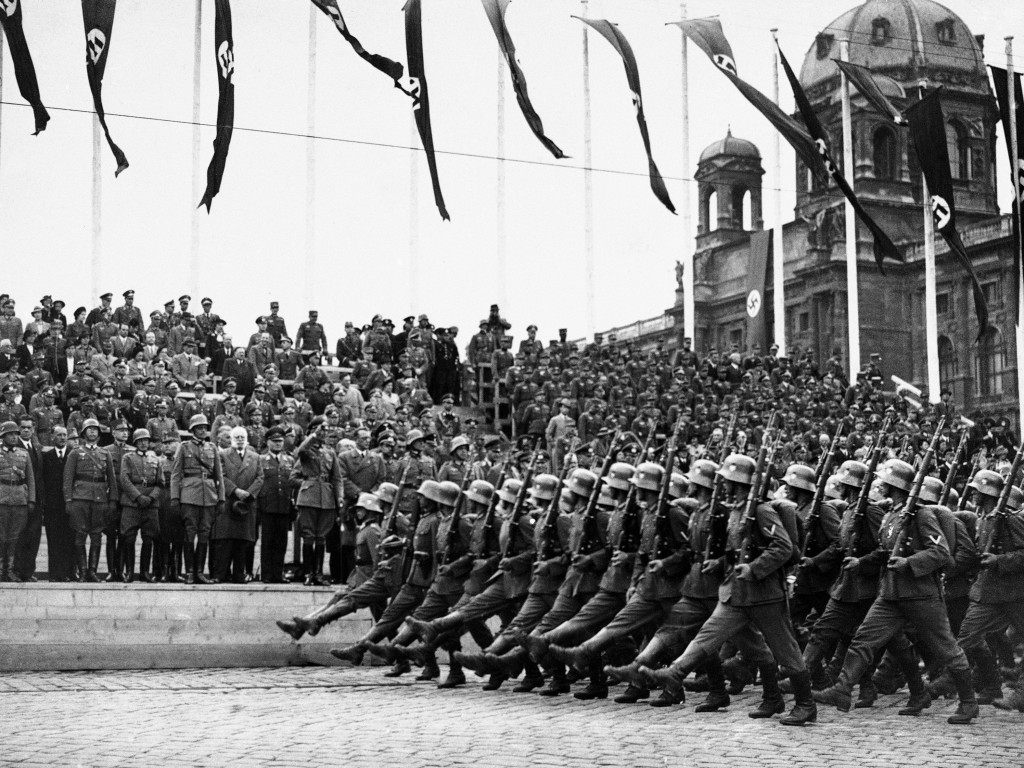 FILE - In this March 24, 1938, file photo, German standard bearers parade past Maj. Gen. Fedor von Bock, commander of all armed forces in the Austrian...