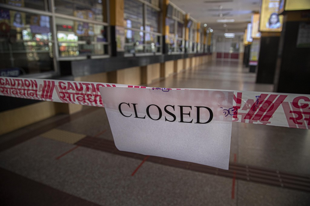 A sign hangs at an empty railway station during lockdown in Gauhati, India, Wednesday, March 25, 2020. The world's largest democracy went under the wo...