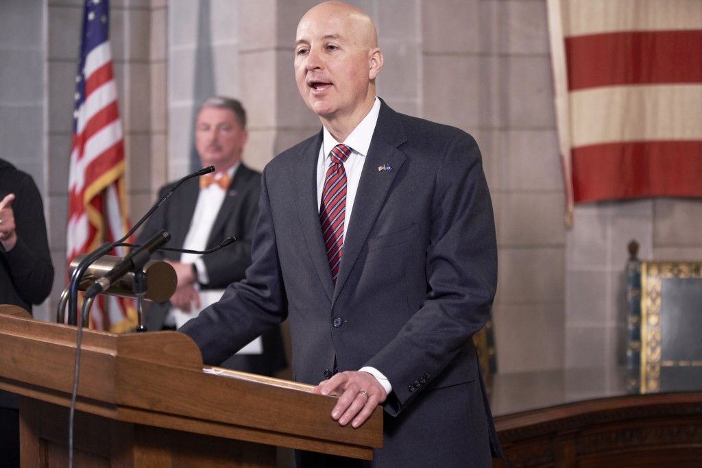 In this March 20, 2020 photo, Neb., Gov. Pete Ricketts speaks during a press briefing on the coronavirus in Lincoln, Neb., as Jim Macy, Director of th...