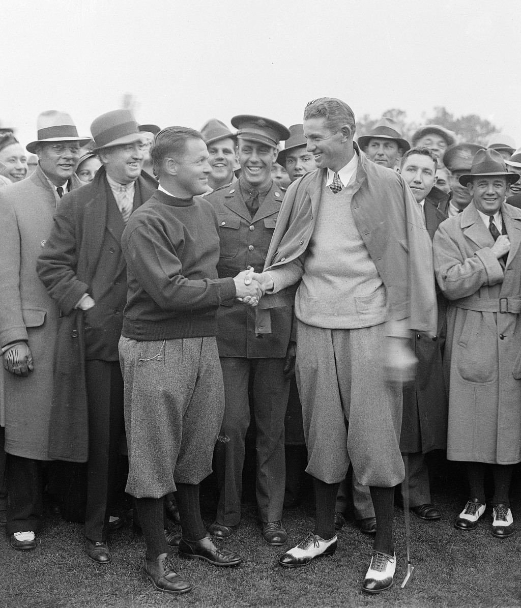 FILE - In this March 25, 1934 file photo Horton Smith, right, is congratulated by golf legend and Masters co-founder Bobby Jones after winning the fir...