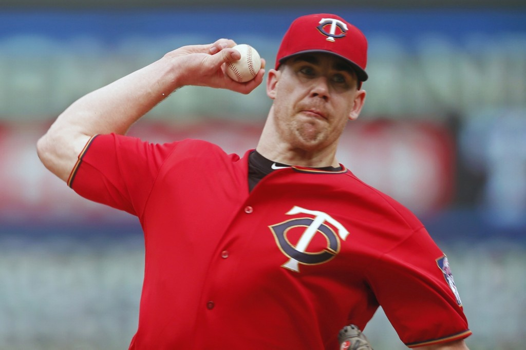 FILE - In this June 27, 2019, file photo, Minnesota Twins relief pitcher Trevor May throws against the Tampa Bay Rays during a baseball game in Minnea...