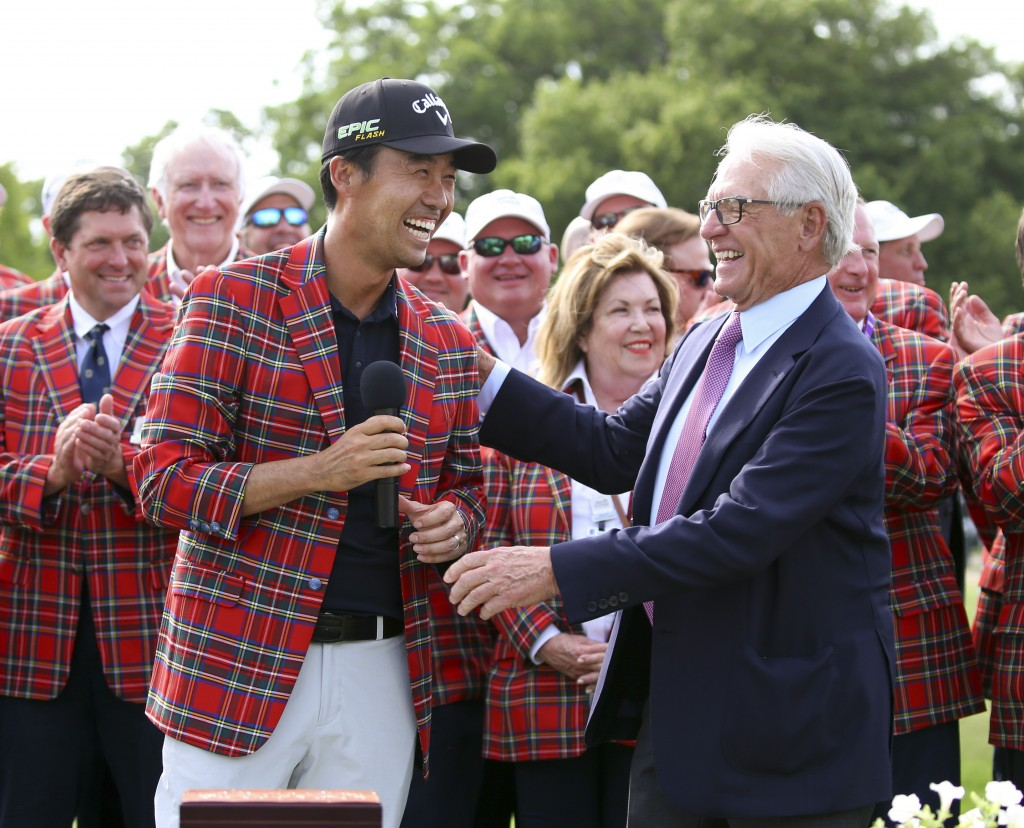 FILE - In this May 26, 2019, file photo, Kevin Na, front left, is congratulated by Charles Schwab after winning the Charles Schwab Challenge golf tour...