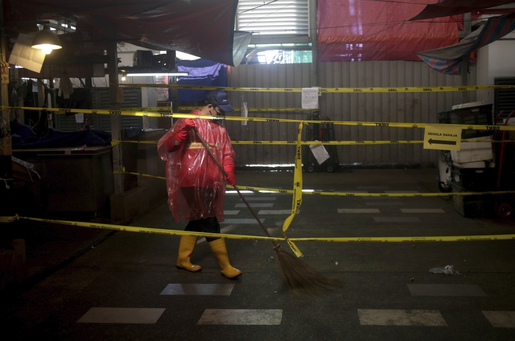 A worker cleans a wet market closed during the restricted movement order due to the outbreak of the coronavirus disease (COVID-19) outside of Kuala Lu...