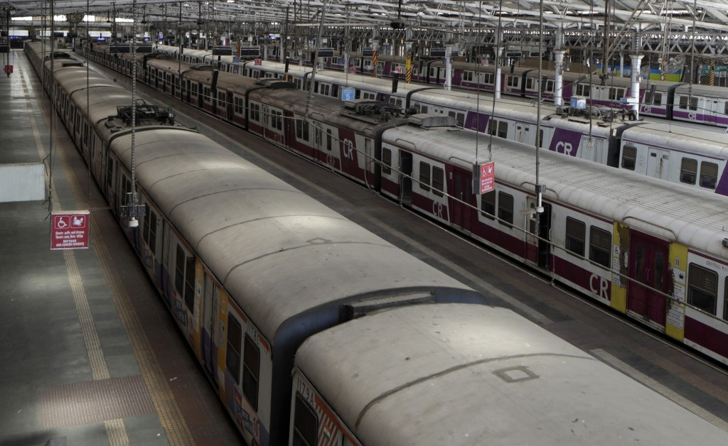 Trains stand parked at Chhatrapati Shivaji Maharaj Terminus after the country halted its railway network in Mumbai, India, Tuesday, March 24, 2020. In...