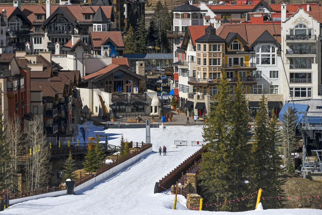 In this Tuesday, March 24, 2020, photo it is mostly deserted after the Vail Ski Resort closed for the season amid the COVID-19 pandemic, in Vail, Colo...