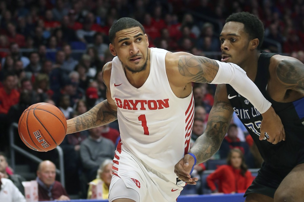 FILE - In this Feb 1, 2020, file photo, Dayton's Obi Toppin (1) drives to the basket against St. Louis forward Jimmy Bell Jr. (32) during the second h...