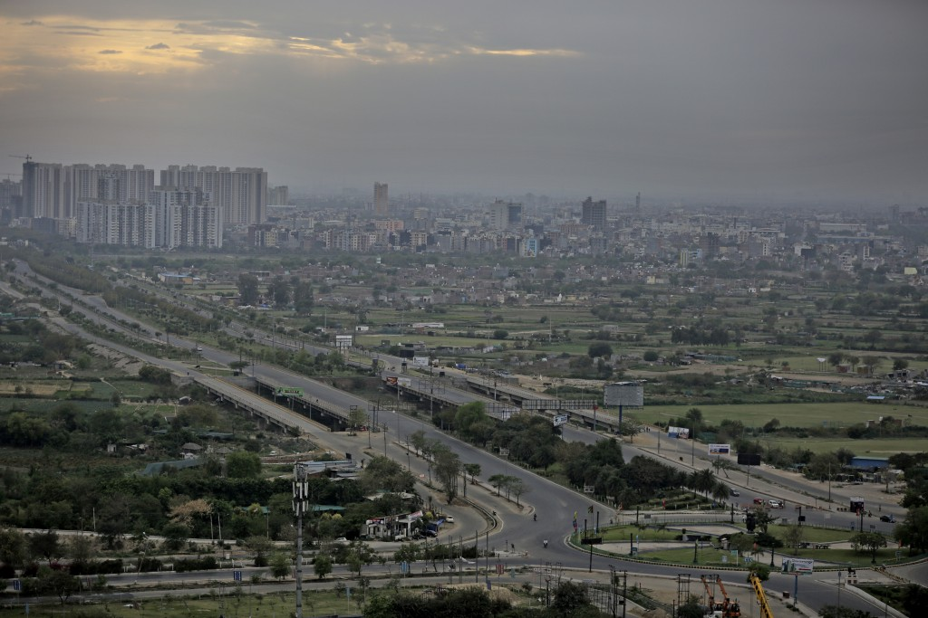 Roads are seen deserted during a lockdown in Greater Noida, a suburb of New Delhi, India, Thursday, March 26, 2020. Some of India's legions of poor an...