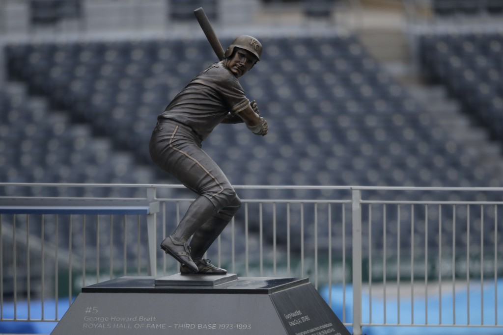 A statue of Major League Baseball Hall of Fame member George Brett stands against empty seats at Kauffman Stadium, home of the Kansas City Royals base...