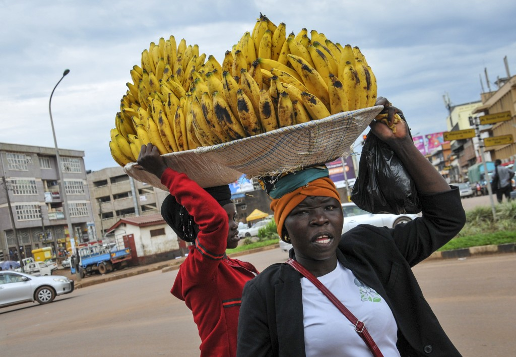Women sell bananas in the street, after traders in markets were prohibited from selling any non-food items in an attempt to halt the spread of the new...