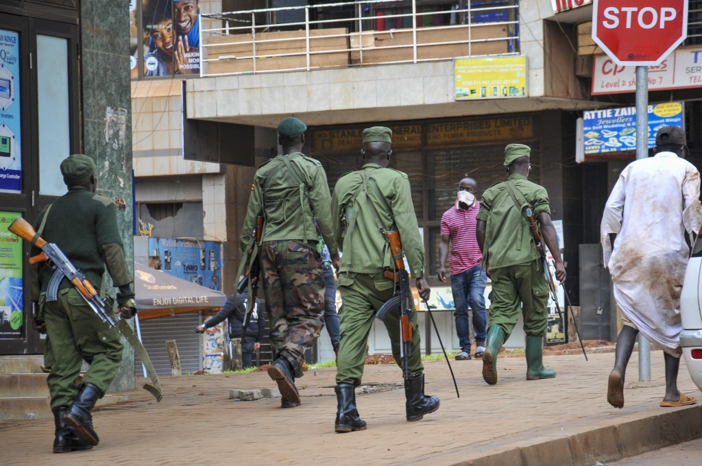 Ugandan police and other security forces chase people off the streets to avoid unrest, after police cleared a stand of motorcycle taxis which are no l...