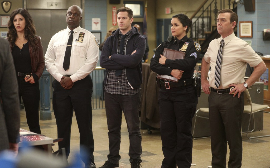 "This image released by NBC shows the cast of the comedy series ""Brooklyn Nine-Nine,"" from left, Stephanie Beatriz, Andre Braugher, Andy Samberg, Melis..."